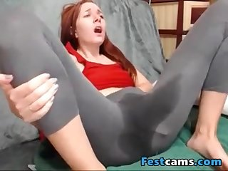 High puny ginger-haired spraying in yogapants