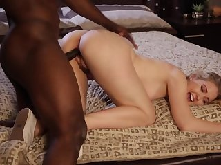 A hot blonde babe is getting fucked by a large black dude