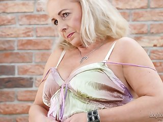 Slutty granny Victoria Hope shows her chesty stretched pussy and big saggy boobies