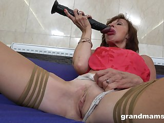 Grown up masturbates with a dildo thinking about friend's hard pecker