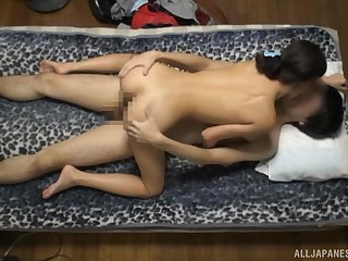 Amateur Japanese angel rides the dick with talisman