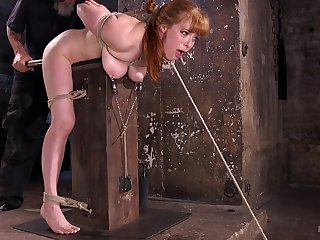 Busty redhead spanked added to clamped in brutal XXX