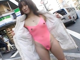 Amateur Japanese girl drops her panties in chum around with annoy matter of flash in chum around with annoy public