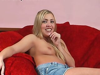 Foxy blondie Karen Wood moans while carrying-on surrounding a large dildo