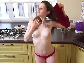 Provocative babe Anita Rose loves pleasuring her pussy in the kitchen